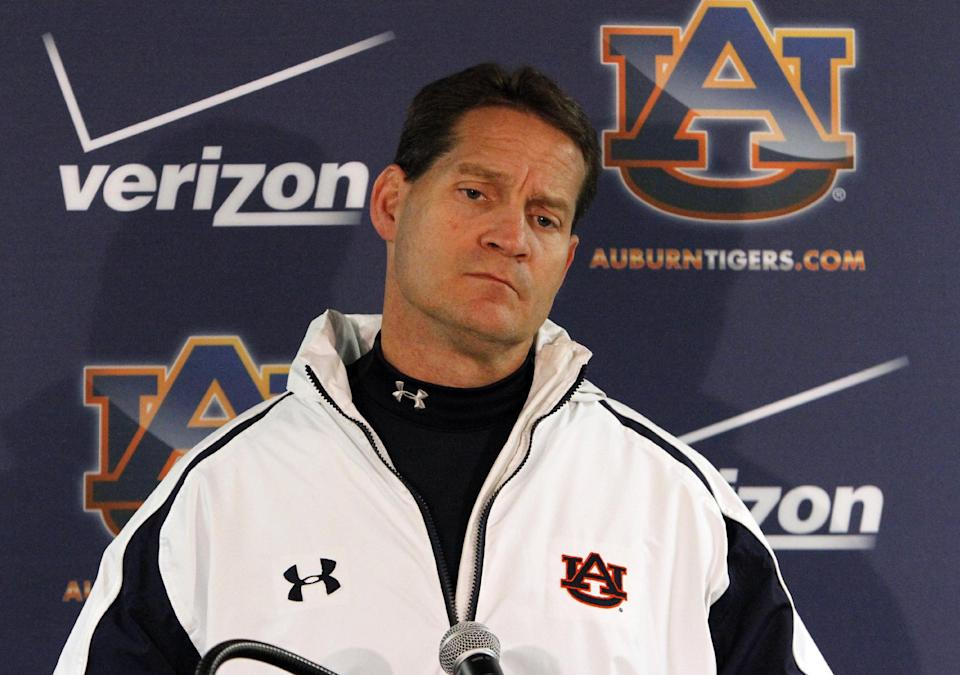 Auburn coach Gene Chizik  talks to the media after a loss to Alabama 49-0 in an NCAA college football game on Saturday, Nov. 24, 2012, in Tuscaloosa, Ala. Chizik would not answer questions about his future at Auburn. (AP Photo/Butch Dill)