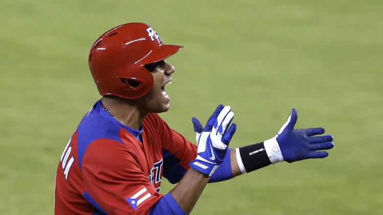 Puerto Rico's Luis Figueroa celebrates after getting a base hit during the ninth inning of the second-round elimination game of the World Baseball Classic against the United States, Friday, March 15, 2013, in Miami. Puerto Rico defeated the U.S. 4-3. (AP Photo/Wilfredo Lee)