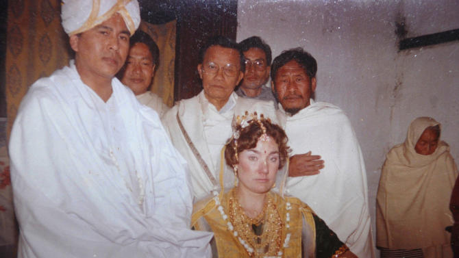 """This undated family photograph shows Jupiter Yambem during his marriage to Nancy, center. Jupiter was a banquet manager in the Windows on the World restaurant atop one of the towers, and was originally from the small northeastern Indian state of Manipur. His brother, Yambem Laba believes the U.S. had no choice but to wage war and hunt for Osama bin Laden. """"The WTC attack was the spark and the flame was the war,"""" he says. Each anniversary, up to 150 family members and friends honor Jupiter's memory with a Hindu lunch, prayer ceremony and floral offerings to his portrait. With bin Laden's recent death, this year's gathering will be special, Laba says. """"The aftereffect of 9/11 is that the war on terrorism took a different turn,"""" Laba says. """"Earlier you could say one man's terrorist is another man's freedom fighter, but that no longer held true."""" (AP Photo)"""
