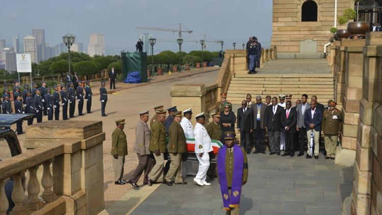 GCIS handout of military personnel carrying the remains of former South African President Nelson Mandela at the Union Buildings in Pretoria