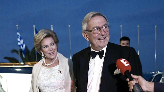 Former King Constantine II of Greece, right , and his wife Queen Anne-Marie, arrive at the Yacht Club of Greece in Piraeus, near Athens, on Thursday, Sept. 18, 2014. Former King Constantine II of Greece and former Queen Anne-Marie  celebrate Thursday their Golden wedding anniversary with royals from all over Europe. (AP Photo/Petros Giannakouris)
