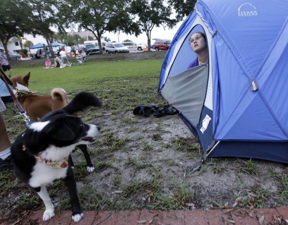 Sarah Paschall, of Jacksonville, Fla., looks out from her tent as she waits for the launch of space shuttle Atlantis Friday, July 8, 2011, in Titusville, Fla. Atlantis is scheduled to liftoff Friday on the final space shuttle mission. (AP Photo/David J. Phillip)