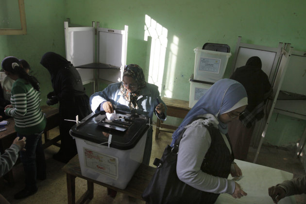 Egyptian woman casts a ballot at a polling station in the second round of a referendum on a disputed constitution drafted by Islamist supporters of President Mohammed Morsi in Giza, Egypt, Saturday, Dec. 22, 2012. (AP Photo/Amr Nabil)