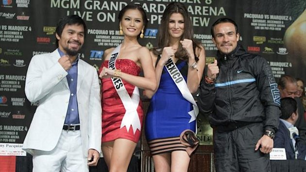 Filipino boxer Manny Pacquiao (L) and Juan Manuel Marquez of Mexico pose with Miss Universe contestants Miss Philippines Janine Tugonon and Miss Mexico Karina Gonzalez during a news conference at the MGM Grand in Las Vegas (Reuters)