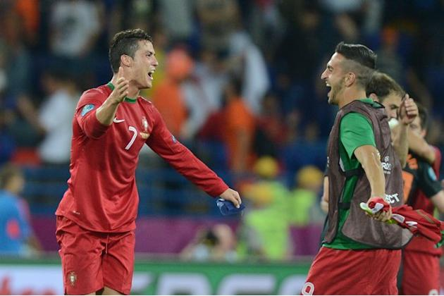 Portuguese Forward Cristiano Ronaldo (L) Celebrates  AFP PHOTO / PATRICK HERTZOGPATRICK HERTZOG/AFP/GettyImages AFP/Getty Images