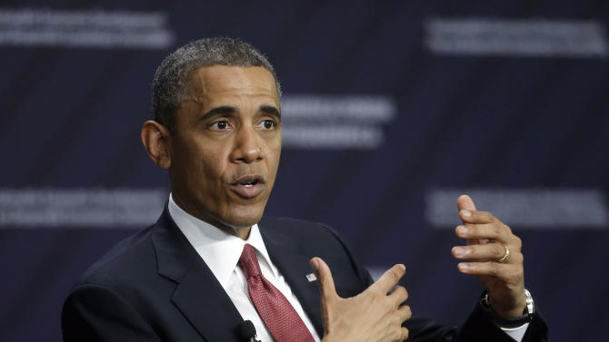 Issues back home trail Obama on Latin America trip