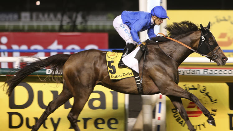 Sajjhaa from Great Britain, ridden by Silvestre De Sousa, crosses the finish line to win the Dubai Duty Free at Meydan racecourse in Dubai, United Arab Emirates, Saturday, March 30, 2013. (AP Photo/Kamran Jebreili)