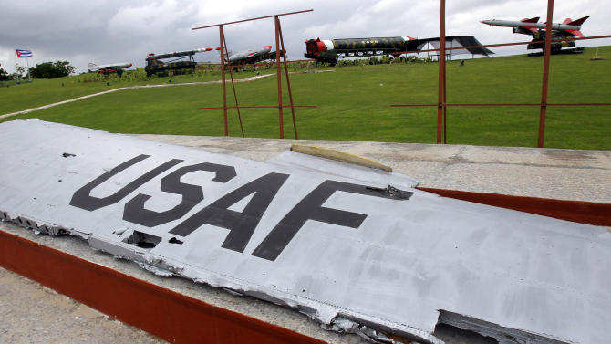 The wing of a U.S. Air Force plane, front, sits on exhibit along with the old, empty outer casings of Soviet missiles, top, at the military complex Morro Cabana which is open to tourists in Havana, Cuba, Saturday, Oct. 13, 2012. The Cuban government says the wing belonged to the plane of U.S. pilot Rudolf Anderson who was killed on Oct. 27, 1962, when his reconnaissance aircraft was shot down while over flying Cuban air space during the Cuban Missile Crisis.  On the eve of the 50th anniversary of the Cuban missile crisis, historians now say it was behind-the-scenes compromise rather than a high-stakes game of chicken that resolved the faceoff, that both Washington and Moscow wound up winners and that the crisis lasted far longer than 13 days. (AP Photo/Ismael Francisco, Cubadebate)