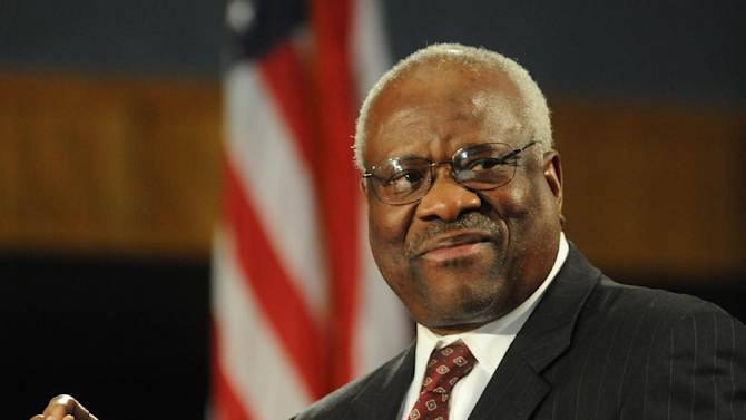 """Supreme Court Justice Clarence Thomas is on stage at the Duquesne University School of Law for """"An Afternoon with Justice Clarence Thomas U.S. Supreme Court"""" in the Duquesne Union Ballroom on Tuesday April 9, 2013, in Pittsburgh.     (AP Photo/Tribune Review,Sidney Davis)  PITTSBURGH OUT    MANDATORY CREDIT"""