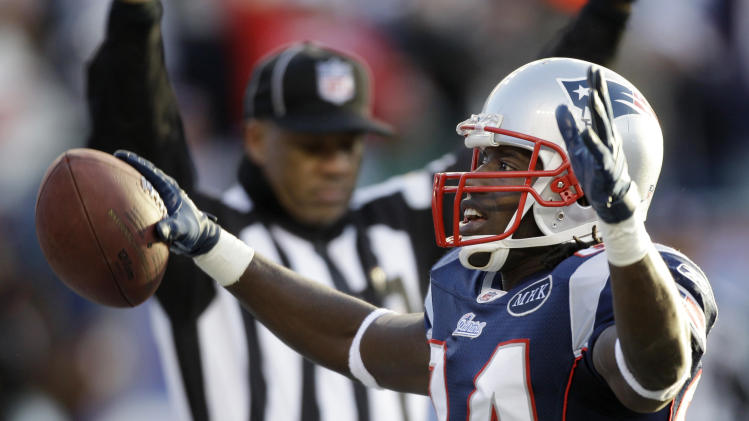 New England Patriots wide receiver Deion Branch (84) celebrates in the end zone after his touchdown against the Miami Dolphins during the third quarter of an NFL football game at Gillette Stadium in Foxborough, Mass. Saturday, Dec. 24, 2011. (AP Photo/Stephan Savoia)