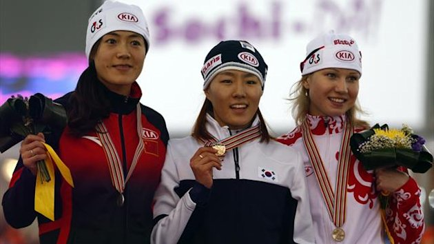 Second placed Beixing Wang of China, winner Sang-Hwa Lee of South Korea and third placed Olga Fatkulina of Russia (L-R) celebrate on the podium after the women's 500m event at the Essent ISU World Single Distances Championships 2013 in Sochi (Reuters)
