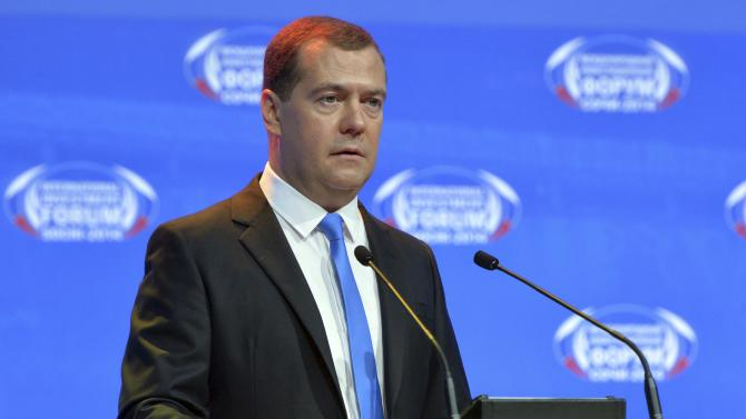 "Russian PM Medvedev speaks during a session of the International Investment Forum ""Sochi-2014"" in Sochi"
