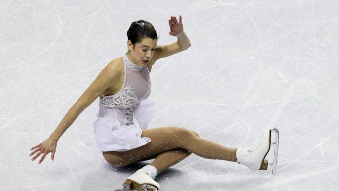 Alissa Czisny falls while competing in the ladies' free skate event at the U.S. Figure Skating Championships in San Jose, Calif., Saturday, Jan. 28, 2012. (AP Photo/Jeff Chiu)
