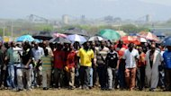 Hundreds of miners sacked by the world's largest platinum producer in South Africa walk on October 6 to a hill where they mourned a colleague who was killed in clashes with police. Representatives of 12,000 fired Anglo American Platinum workers in South Africa said Sunday they plan to lay murder charges against police over the colleague's death