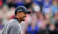 Tiger Woods of the US reacts after holing his shot from a green-side bunker on the 18th hole during his second round of the 2012 British Open Golf Championship at Royal Lytham and St Annes in England