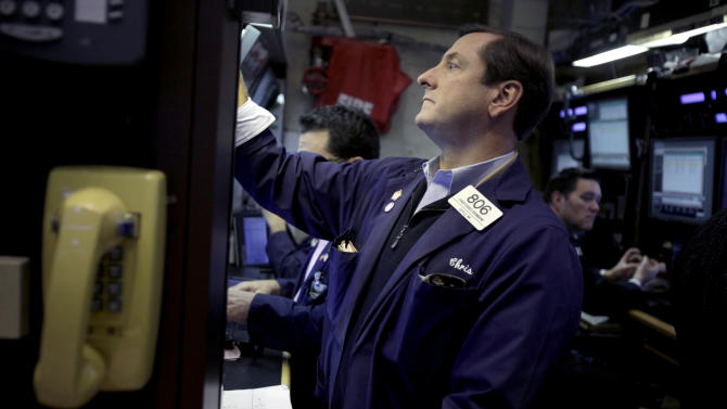 FILE - In this Nov. 15, 2012, file photo, traders work on the floor at the New York Stock Exchange, in New York. World stock markets meandered Tuesday, Dec. 4, as traders weighed a surprise drop in U.S. factory production against hopes that the U.S. will avoid the so-called fiscal cliff. (AP Photo/Seth Wenig, File)