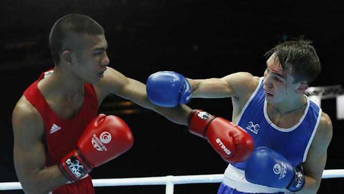 Michael Conlan of Northern Ireland, left, fights Matthew Martin from Nauru during their men's bantam weight (56kg) boxing bout at the Commonwealth Games Glasgow 2014, in Glasgow, Scotland, Friday, July, 25, 2014. (AP Photo/Alastair Grant)