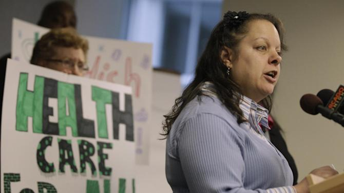 Ramona Ortiz-Patino, right, one of two former patients of Swedish Covenant Hospital who are now plaintiffs in a lawsuit against the health care facility speaks at a news conference Thursday, Nov. 29, 2012 in Chicago. The lawsuit claims that the nonprofit hospital failed to provide charity care to low-income uninsured patients which is required by law in exchange for state tax break benefits. (AP Photo/M. Spencer Green)