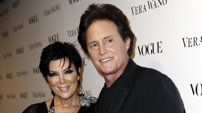 FILE - This March 2, 2010 file photo shows Kris Jenner, left, and Bruce Jenner at the Vogue Magazine dinner celebrating the launch of the Vera Wang store on Melrose in West Hollywood, Calif. A Los Angeles judge signed the Jenners' divorce judgment on Tuesday Dec. 16, 2014, but the couple will have to wait until March 2015 until they are legally single. The judgment gives Kris Jenner the pair's home and several vehicles, but requires her to pay $2.5 million to her husband of 23 years. (AP Photo/Matt Sayles, File)