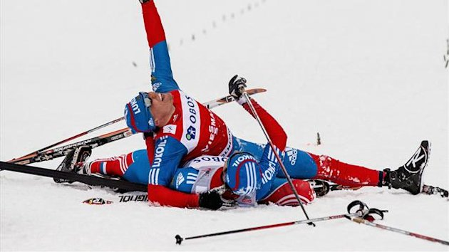 Alexander Legkov (top) of Russia celebrates after winning the men&#39;s 50 km mass start WC cross country competition in the Holmenkollen Ski Arena in Oslo