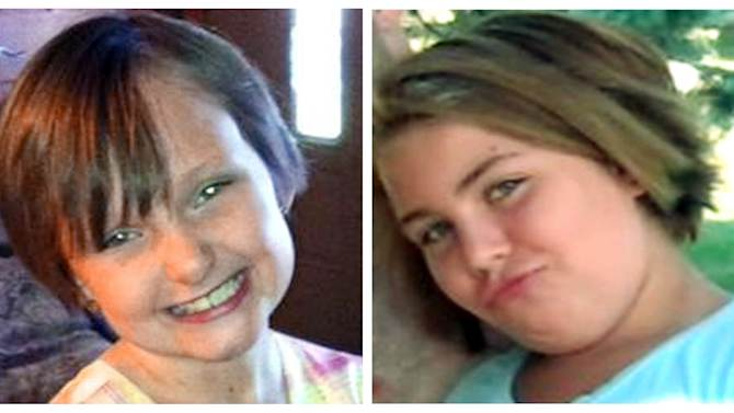 This combo made from undated photos provided by the FBI shows cousins Lyric Cook, 10, right, and Elizabeth Collins, 8, who have been missing since Friday, July 13, 2012. Authorities say hunters have found bodies believed to be two young Iowa cousins who disappeared while riding their bikes in July. (AP Photo/FBI)