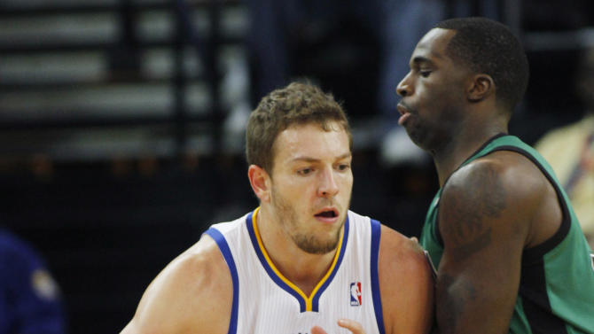 Golden State Warriors' David Lee drives toward the basket as Boston Celtics' Brandon Bass defends during the first half of an NBA basketball game in Oakland, Calif., Saturday, Dec. 29, 2012. (AP Photo/George Nikitin)