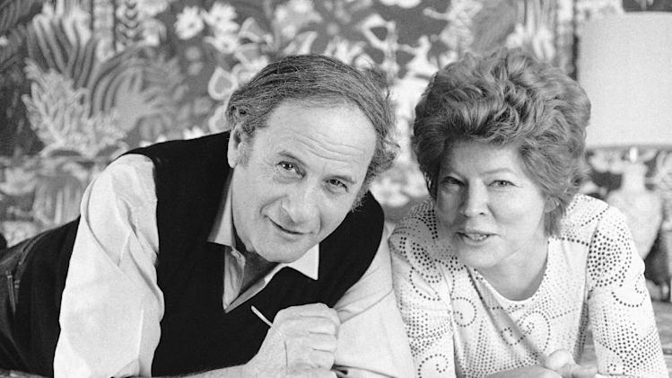 "FILE - This April 27, 1972 file photo shows actor Eli Wallach, left, and his wife Anne Jackson from the Broadway comedy ""Promenade All!"" in New York. Wallach, the raspy-voiced character actor who starred in dozens of movies and Broadway plays over a remarkable and enduring career, died Monday, June 23, 2014 of natural causes. He was 98. (AP Photo/Jerry Mosey, File)"