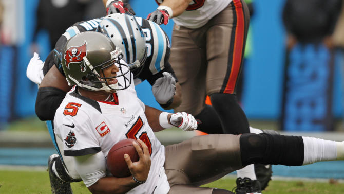 Tampa Bay Buccaneers' Josh Freeman (5) is hit as he slides by Carolina Panthers' James Anderson (50) during the first half of an NFL football game in Charlotte, N.C., Sunday, Nov. 18, 2012. Anderson was called for a personal foul. (AP Photo/Nell Redmond)