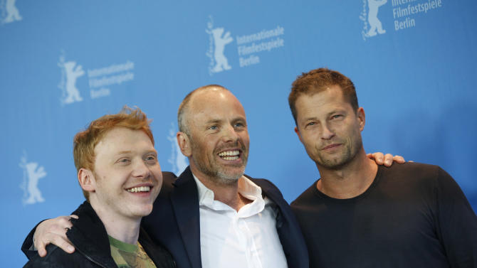 Actor Rupert Grint, director Fredrik Bond and actor Til Schweiger, from left, pose at the photo call for the film The Necessary Death Of Charlie Countryman at the 63rd edition of the Berlinale, International Film Festival in Berlin, Germany, Saturday, Feb. 9, 2013. (AP Photo/Gero Breloer)