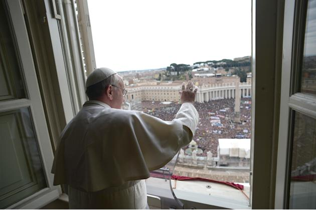 In this photo provided by the Vatican paper L'Osservatore Romano, Pope Francis delivers his Angelus prayer from the window of his studio overlooking St. Peter's Square, at the Vatican, Sunday, March 1