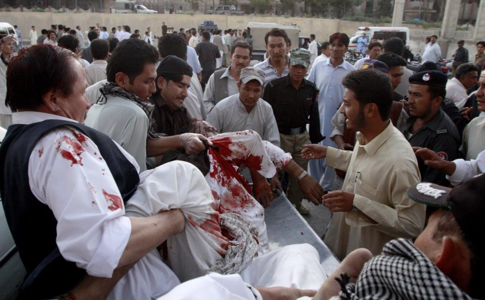 People rush a shooting victim into hospital in Quetta, Pakistan, on Tuesday, Sept. 20, 2011, after gunmen opened fire on minority Shiite Muslim pilgrims traveling through southwest Pakistan.  The shooting left 26 people dead and an unknown number injured, in an apparent sectarian attack, officials and survivors said. (AP Photo/Arshad Butt)