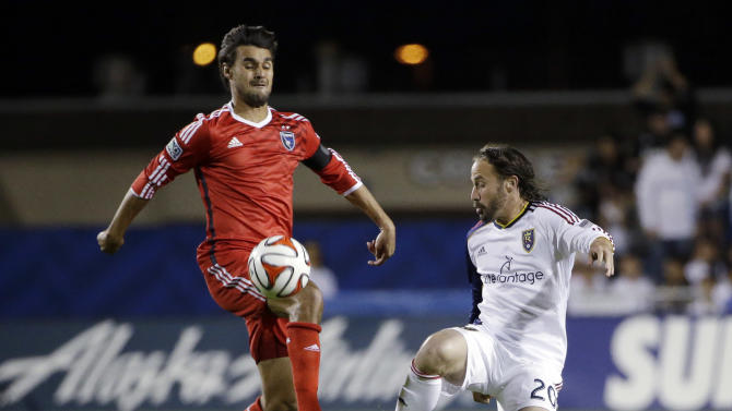 San Jose Earthquakes forward Chris Wondolowski, left, controls the ball next to Real Salt Lake midfielder Ned Grabavoy during the first of an MLS soccer match Saturday, March 15, 2014, in Santa Clara, Calif