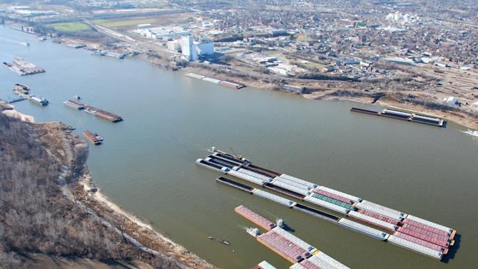 In this Dec. 12, 2012 photo provided by the United States Coast Guard, barges crowd one of the busiest fleeting areas, where barges are stored, loaded and unloaded, on the Mississippi River South of St. Louis. Barge operators along a key stretch of the Mississippi River braced Monday, Dec. 17, for months of restricted shipping as crews prepared to begin blasting large rock formations that are impeding navigation on the drought-plagued waterway. (AP Photo/U.S. Coast Guard, Colby Buchanan)