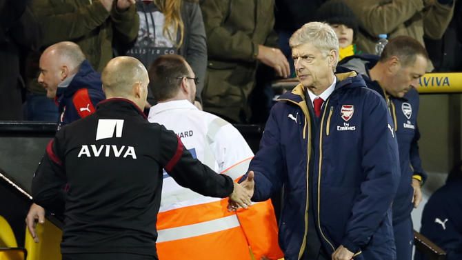 Arsenal manager Arsene Wenger and Norwich manager Alex Neil shake hands at the end of the game