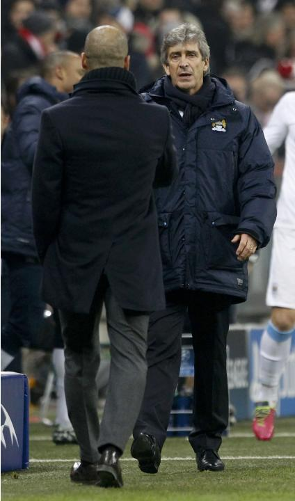 Manchester City coach Pellegrini and Bayern Munich coach Guardiola shake hands after their Champions League Group D soccer match in Munich