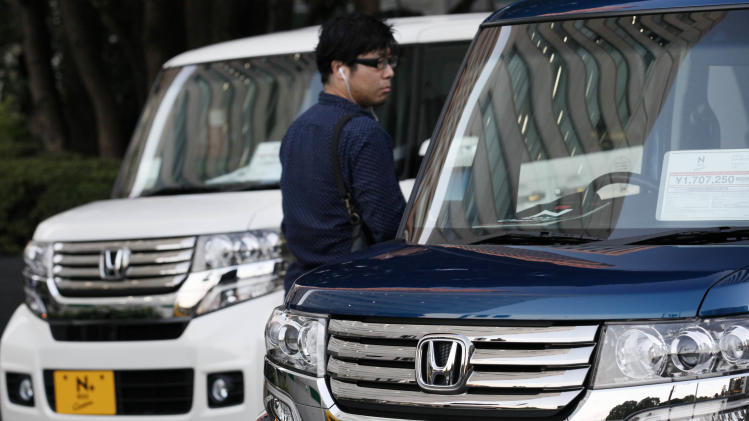 Honda profit surges, trims forecast on China