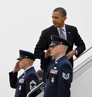 President Barack Obama boards Air Force One before his departure from Andrews Air Force Base, Md., Friday, March, 16, 2012. Obama is traveling to Chicago and Atlanta for campaign fundraisers. (AP Photo/Pablo Martinez Monsivais)
