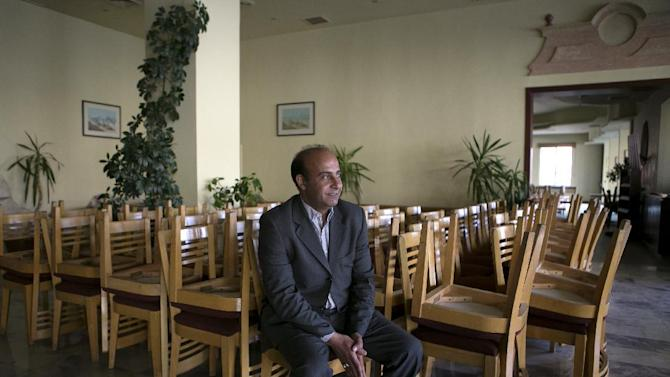 """In this Tuesday, March 24, 2015 photo, Ahmad Amarat, manager of the Kings' Way Hotel, speaks during an interview with The Associated Press in the ancient city of Petra, Jordan. """"We are not optimistic for 2015,"""" Amarat said. The hotel closed four months ago after an average occupancy rate of 28 percent for 2014, compared to 95 percent in 2010. (AP Photo/Raad Adayleh)"""