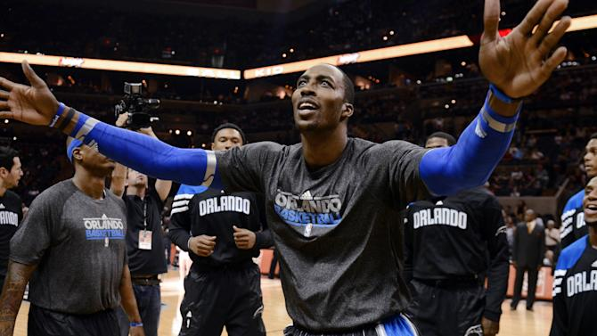 Orlando Magic center Dwight Howard gestures during introductions for an NBA basketball game between the Magic and the San Antonio Spurs on Wednesday, March 14, 2012, in San Antonio. AP Photo/Bahram Mark Sobhani)