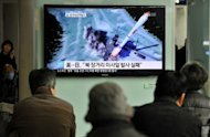 "South Korean people watch a TV screen showing a graphic of North Korea's rocket launch in Seoul in April 2012. The UN Security Council on Wednesday ordered sanctions against three ""very significant"" North Korean entities over the country's failed rocket launch last month, US ambassador Susan Rice said"