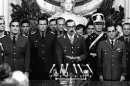 FILE - In this March 24, 1976 file photo, Gen. Jorge Rafael Videla, center, is sworn-in as president at the Buenos Aires Government House accompanied by Adm. Emilio Massera, second from left, and Brig. Orlando Agosti, second from right, members of the junta that overthrew President Isabel Peron. The former Argentine dictator died of natural causes Friday, May 17, 2013, while serving life sentences at the Marcos Paz prison for crimes against humanity. Videla took power in a 1976 coup and led a military junta that killed thousands of his fellow citizens in a dirty war to eliminate &quot;subversives.&quot; He was 87. (AP Photo/Eduardo Di Baia, File)