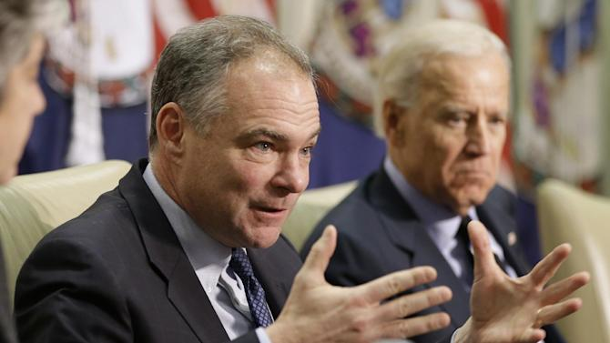 Sen. Tim Kaine, D-Va., left, accompanied by Vice President Joe Biden, gestures during a round table discussion on gun violence, Friday, Jan. 25, 2013, at Virginia Commonwealth University in Richmond, Va.  The panelists included officials who worked on the aftermath of the Virginia Tech shootings. (AP Photo/Steve Helber)