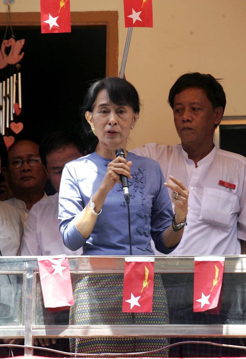 Myanmar opposition leader Aung San Suu Kyi speaks from a balcony of a newly-opened branch office of her National League for Democracy (NLD) party on Tuesday, May 8, 2012, in Yangon, Myanmar. (AP Photo/Khin Maung Win)