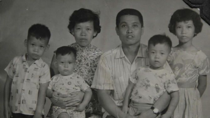 In this undated family photo released Saturday, Nov. 17, 2012, Juan Chiu Trujillo, a Chinese Mexican , third from right, poses with his wife and children. Chiu who was born in Mexico, was among thousands of Chinese Mexicans expelled when Mexico erupted into xenophobia fueled by the economic turmoil of the Great Depression.  Chiu returned in 1960, along with his pregnant wife and four children and 300 other Chinese-Mexicans, after President Adolfo Lopez Mateos paid for their travel expenses and decreed that they would be legally allowed to live in Mexico. Dozens of those Chinese-Mexicans and their descendants gather Saturday, Nov. 24, 2012, at a Chinese restaurant in central Mexico City to celebrate the anniversary of their return. (AP Photo/Chiu Trujillo Family Photo)