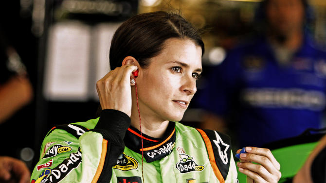Driver Danica Patrick prepares to run practice laps for Saturday night's NASCAR Sprint Cup series auto race at Kentucky Speedway in Sparta, Ky., Friday, June 28, 2013. (AP Photo/Garry Jones)