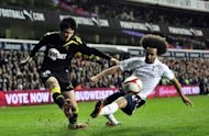 Ryo Miyaichi (left), playing for Bolton Wanderers, vies with Tottenham Hotspur's French defender Benoit Assou-Ekotto (right) during their FA Cup quarter-final replay at White Hart Lane in London on March 27