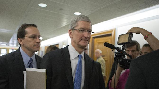 Apple CEO Tim Cook arrives on Capitol Hill, in Washington, Tuesday, May 21, 2013, to testify before the Senate Homeland Security and Governmental Affairs Permanent subcommittee on Investigations hearing to examine the methods employed by multinational corporations to shift profits offshore and how such activities are affected by the Internal Revenue Code.  Cook is expected to defend how the world's most valuable company, based in Cupertino, Calif., holds a billion dollars in an Irish subsidiary as a tax strategy, according to a report issued this week by the subcommittee.  (AP Photo/J. Scott Applewhite)