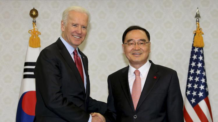 U.S. Vice President Joe Biden shakes hands with South Korean Prime Minister Chung Hong-won before their meeting at the Government Complex in Seoul