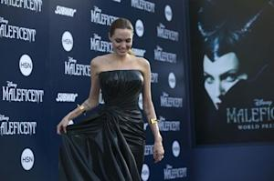 """Cast member Jolie poses at the premiere of """"Maleficent"""" at El Capitan theatre in Hollywood"""
