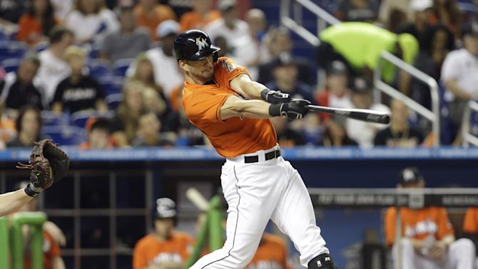 In this Sept. 11, 2013 file photo, Miami Marlins' Justin Ruggiano bats during a baseball game against the Atlanta Braves, in Miami. The Chicago Cubs obtained the right-handed outfield bat they needed, acquiring Ruggiano from the Miami Marlins for lefty swinging Brian Bogusevic
